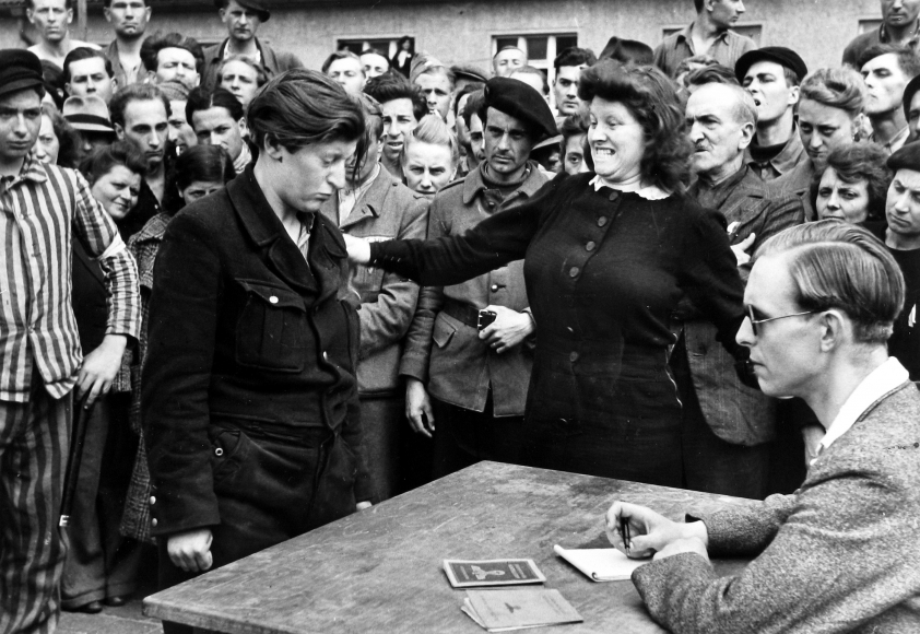 Henri Cartier-Bresson - Among liberated DPs going home an informer of the Gestapo tried to slip among them, Dessau, Germany, 1945 - Howard Greenberg Gallery