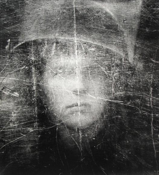 Philip Jones Griffiths - Soldier seen through shield, Northern Ireland, 1973 - Howard Greenberg Gallery