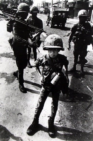 """Philip Jones Griffiths - Called """"Little Tiger"""" for killing two """"Vietcong women cadre"""" - his mother and teacher, it was rumored, 1968 - Howard Greenberg Gallery"""