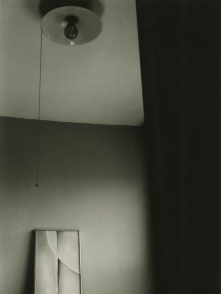 Dorothy Norman - Georgia O'Keefe Painting with Light Bulb, c. 1936 - Howard Greenberg Gallery