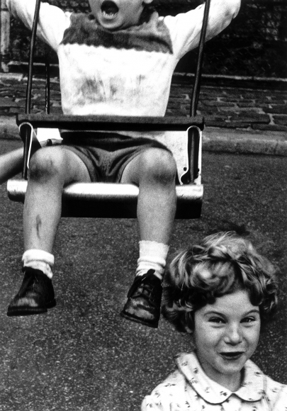 William Klein - Boy + Swing + Simpering Girl, New York, 1955 - Howard Greenberg Gallery
