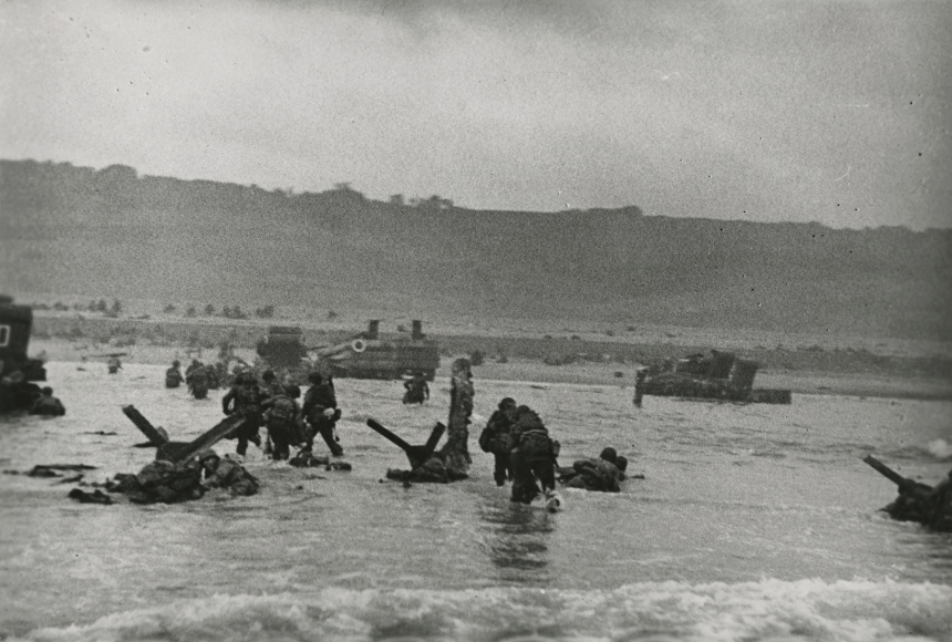 Robert Capa - American soldiers landing on Omaha Beach, D-Day, Normandy, France, 6-Jun-44 - Howard Greenberg Gallery