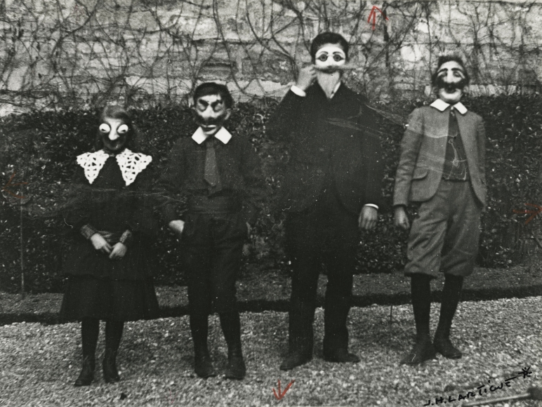 Jacques-Henri Lartigue - Mardi Gras with Bouboutte, Louis, Robert, and Zissou, Paris, 1903 - Howard Greenberg Gallery