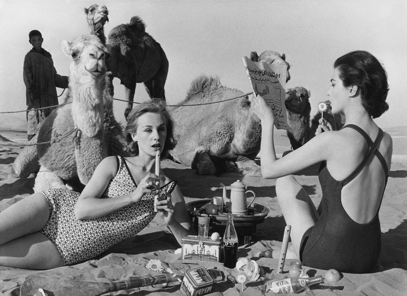 William Klein - Tatiana + Marie Rose + Camels, Picnic, Morocco, 1958 - Howard Greenberg Gallery