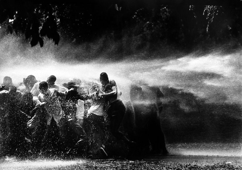Bob Adelman - Water Hosing Demonstrators - Howard Greenberg Gallery