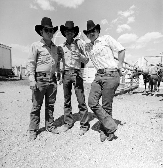 Tom Arndt - Three cowboys, Cheyenne, Wyoming, 1975 - Howard Greenberg Gallery