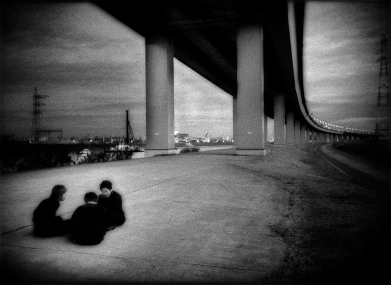 James Whitlow Delano, Mangaland, Conspiratorial schoolboys underneath expressway, Shin Koiwa, Tokyo, 2007, Sous Les Etoiles Gallery