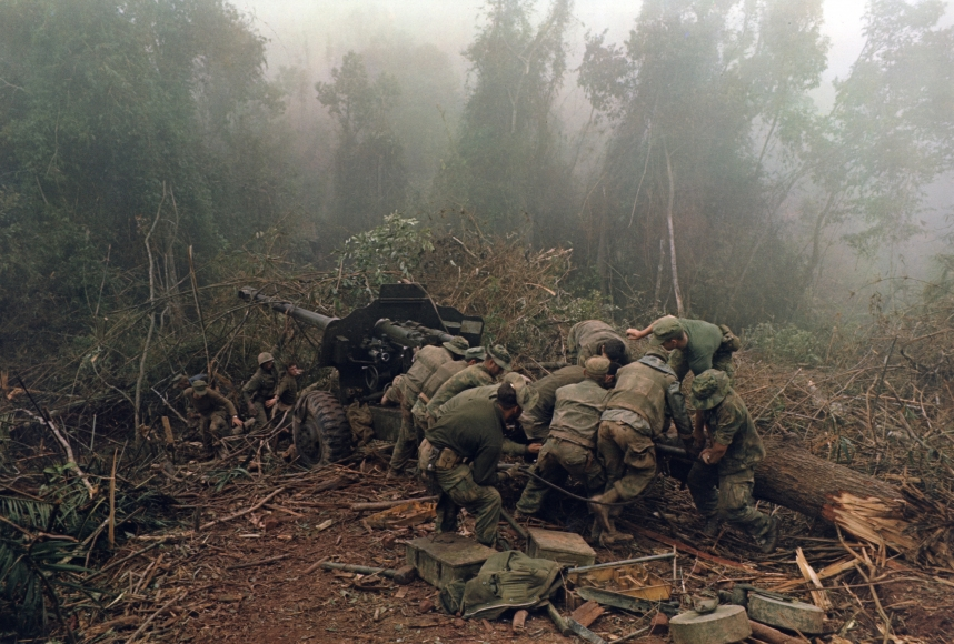 Larry Burrows Inspecting 122 MM artillery piece near Laos border,  1968