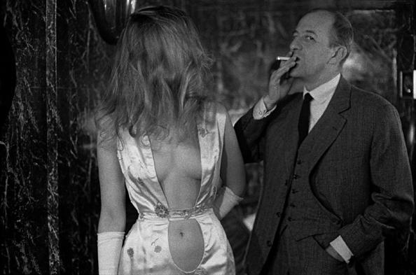 Alain Bernardin, owner of the Crazy Horse Saloon, with stripper Dodo d'Hambourg, Paris, France, 1962