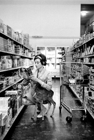 Audrey Hepburn at the market with Ip the deer, 1958