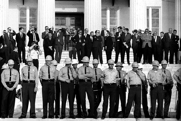 State troopers arrayed on steps of Montgomery, Alabama State House. Officials on top steps, Selma to Montgomery, Alabama Civil Rights March, March 25, 1965