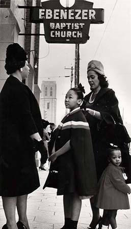 Coretta Scott King and her daughters, Yolanda and Bernice, talk with a fellow parishioner outside Ebenezer Baptist Church in Atlanta, 1963