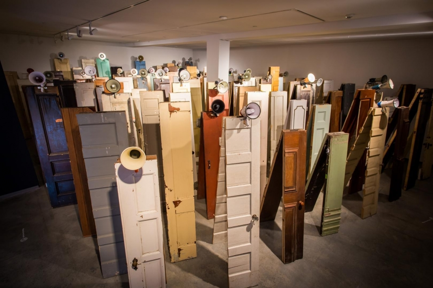 Kader Attia, Asesinos! Asesinos!, 2014, installation view, Kader Attia, Museum of Contemporary Art Australia, Sydney, 2017, 129 wooden doors, 47 megaphones, Vehbi Koç Foundation Contemporary Art Collection, Istanbul, image courtesy the artist and Museum of Contemporary Art Australia © the artist, photograph: Anna Kučera
