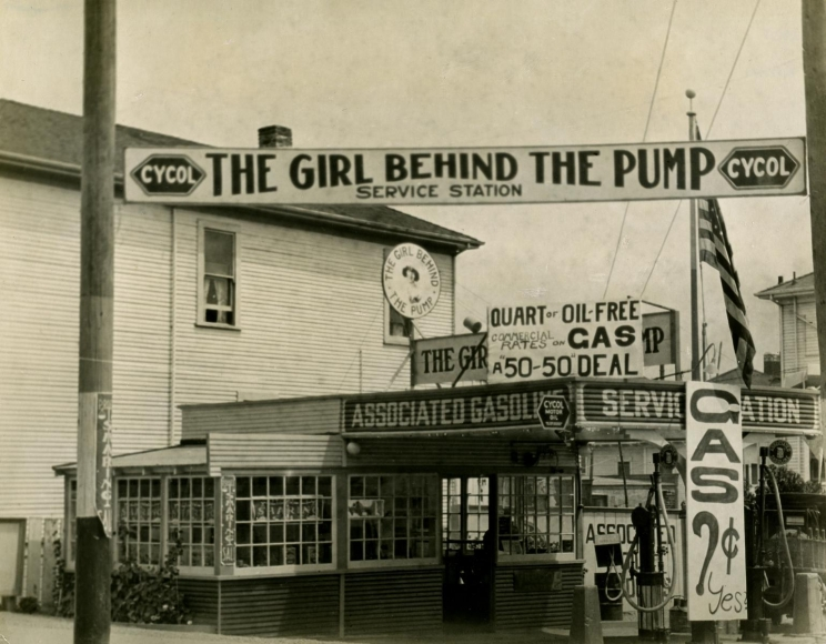 Gas Station, 'The Girl Behind the Pump', Los Angeles, CA, 1926 	Gelatin silver print, printed c. 1926 	7 x 9 inches