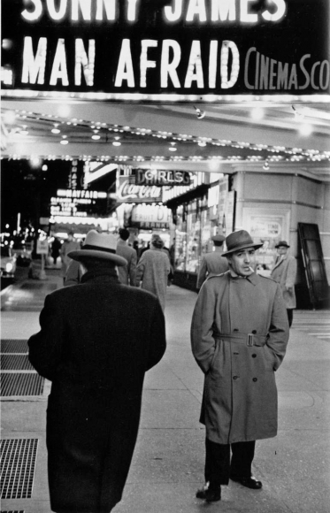 Man Afraid, Times Square, New York City, 1956 	Gelatin silver print, printed later 	14 x 11 inches