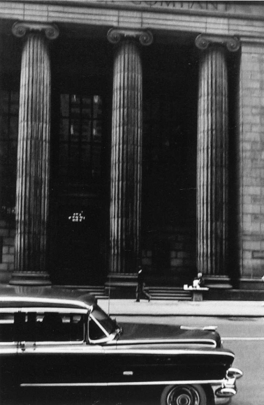 Bank on Wall Street, New York City, 1957 	Gelatin silver exhibition print mounted to board, printed c. 1957 	23 7/8 x 16 inches