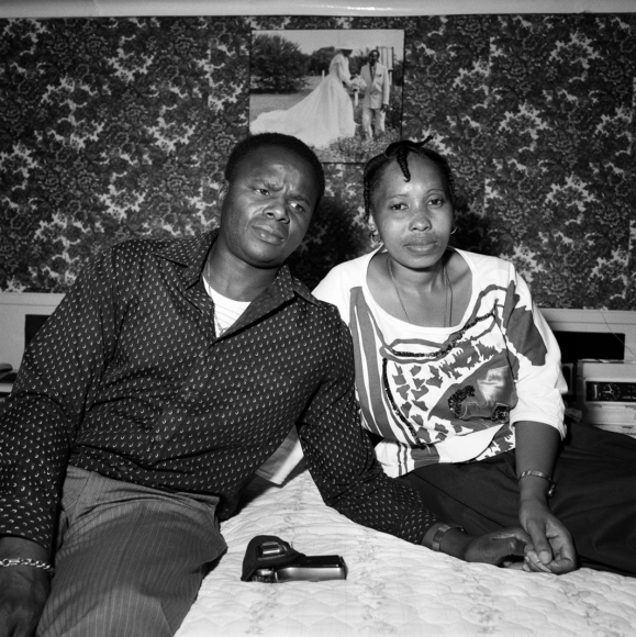 Couple with their wedding picture and their gun, Soweto, South Africa, 1988