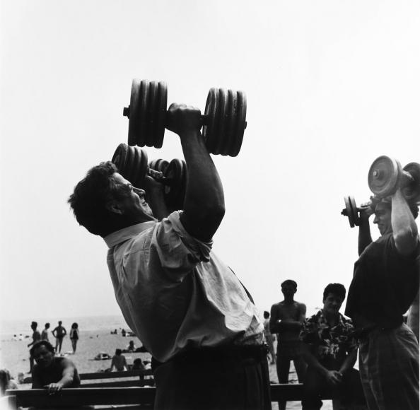 Larry Silver - Man with Dumb-bells, Muscle Beach, Santa Monica, CA, 1954 Gelatin silver print, printed 2011 | Bruce Silverstein Gallery