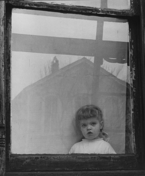 Untitled (Girl in Window), 1951 	Gelatin silver print, printed c. 1951 	12 1/4 x 10 1/4 inches