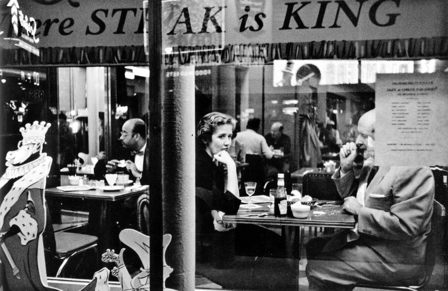 Frank Paulin - Couple in Cafe Window, Times Square, New York City, 1956 Gelatin silver print mounted to board, printed c. later | Bruce Silverstein Gallery