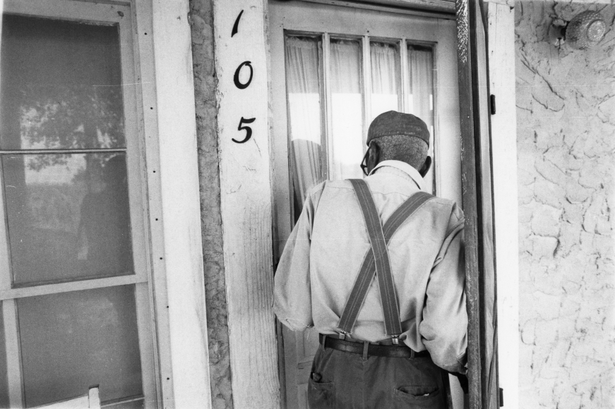 Chester Higgins -  Uncle March Fourth McGowan entering his home, New Brockton, Alabama, 1981