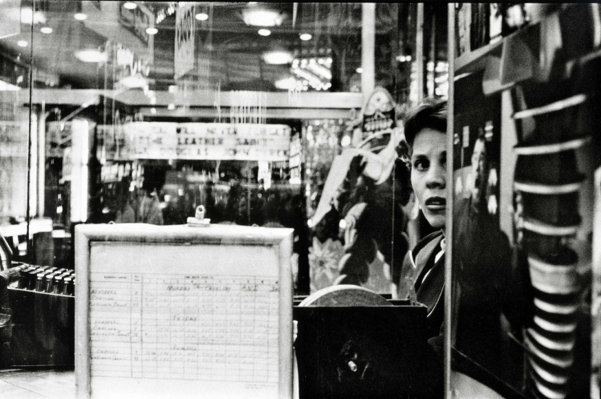 Movie Ticketseller, Times Square, 1957, 	Gelatin silver print