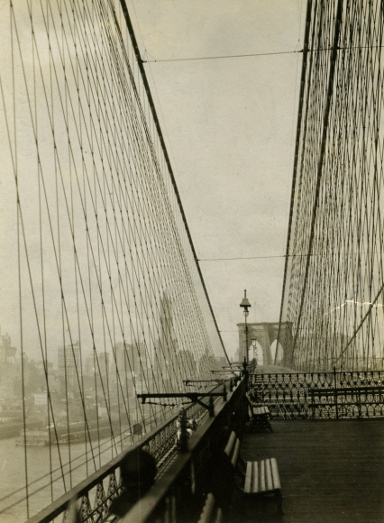 View of Manhattan from the Brooklyn Bridge, 1921 	Gelatin silver print, printed c. 1921 	4 x 3 inches