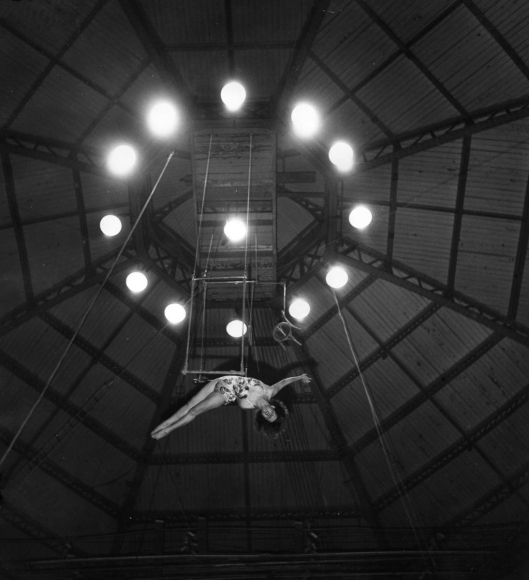 Robert DoisneauJeu du Trapeze Aerien, Paris, 1949 Gelatin silver print, printed c. 1955. 8 1/4 x 7 7/8 inches