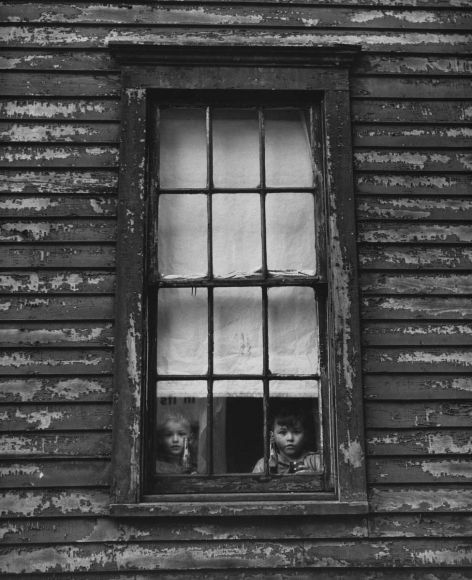 Untitled (Girl and Boy in Window), 1951 	Gelatin silver print, printed c. 1951 	12 1/4 x 10 1/4 inches