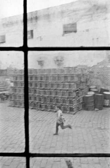 Boy Running, Seville, Spain, 1960 	Gelatin silver print, printed c. 1960 	14 x 11 inches