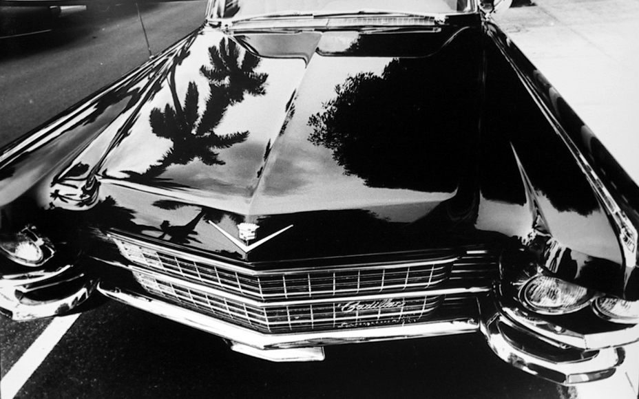 Cadillac on Worth Avenue, Palm Beach, 1967 	Gelatin silver print mounted to board, printed c. later 	11 x 14 inches