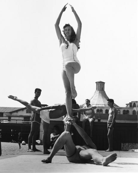 Larry Silver - Woman Being Balanced, Muscle Beach, Santa Monica, CA, 1954 Gelatin silver print, printed later | Bruce Silverstein Gallery