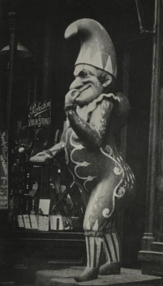 E. O. Hoppé - Wooden Joker Outside Tobacco Shop, New York City, 1926   Bruce Silverstein Gallery