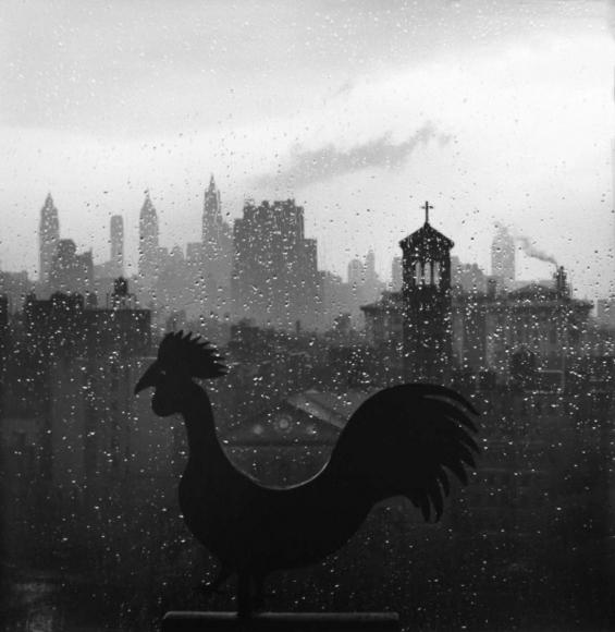 André Kertész - Weather Vane and New York Skyline, September 19, 1952 Gelatin silver print, printed c. 1970s ; Bruce Silverstein Gallery