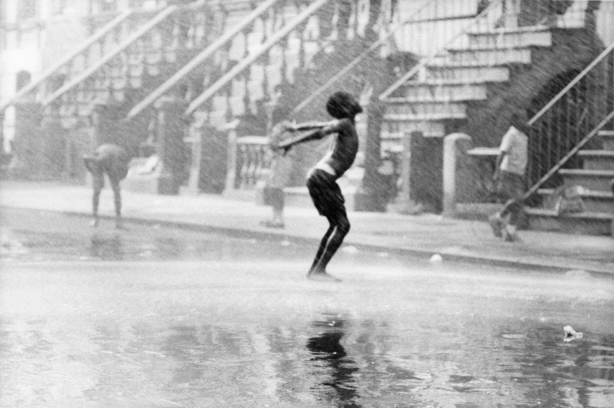 Chester Higgins -  Water spray dancer, Harlem, 1969