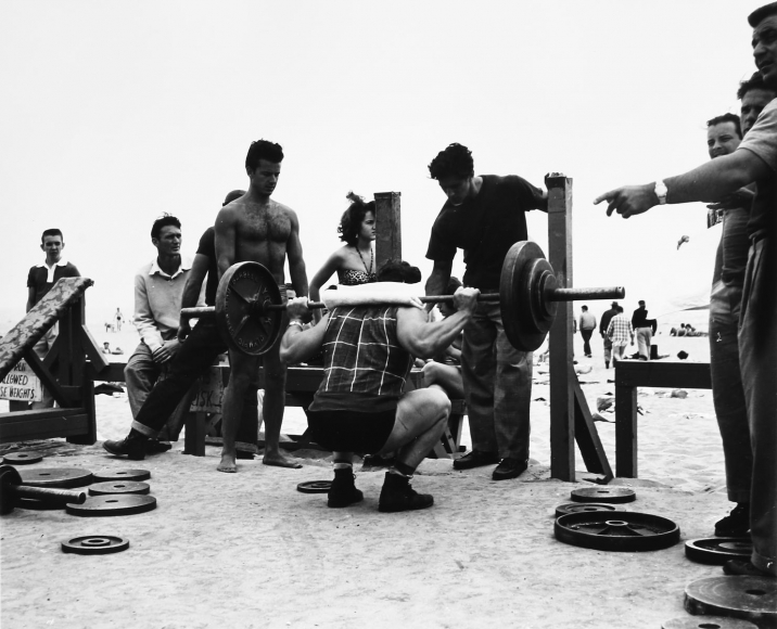 A Body Builder in a Squatting Position, Muscle Beach, Santa Monica, CA, 1954, 	Gelatin silver print, printed later