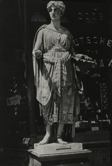 E. O. Hoppé - Wooden Figure Outside Tobacco Shop, New York City, 1926   Bruce Silverstein Gallery