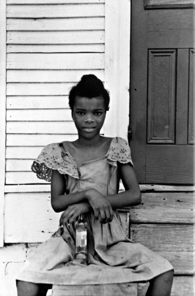 Girl on Steps, New Orleans, 1951 	Gelatin silver print mounted to board, printed c. 1951 	13 1/2 x 9 1/2 inches
