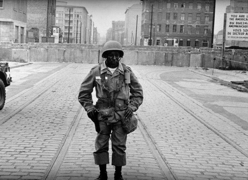 Leonard Freed - Black in White America, American Soldier In Front of the Berlin Wall, 1963  | Bruce Silverstein Gallery