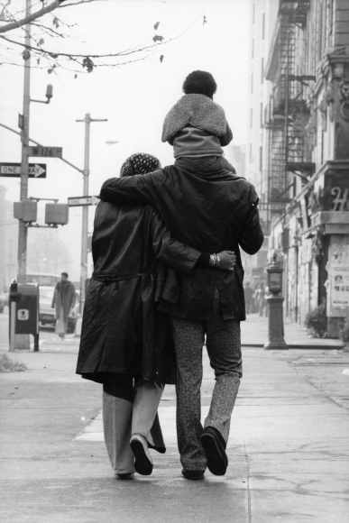 Chester Higgins -  Young Family Strolling, Harlem, 1972