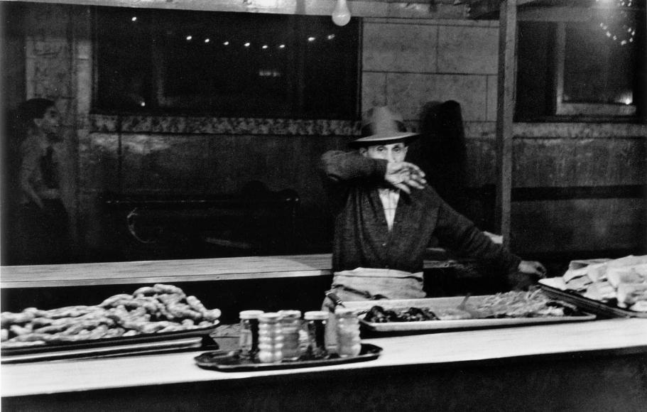 Frank Paulin - Man Behind Food Counter, San Gennaro Festival, New York City, 1959 Gelatin silver print, printed c. 1959 | Bruce Silverstein Gallery