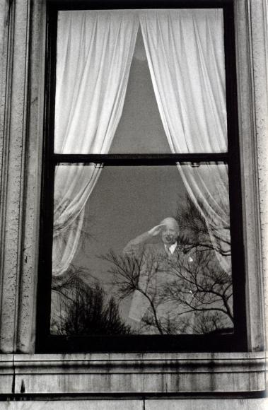 Frank Paulin - Man in Window Saluting, New York City, 1956 Gelatin silver exhibition print mounted to board, printed c. 1956 | Bruce Silverstein Gallery
