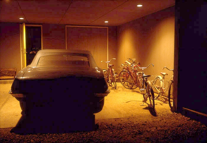 William Eggleston, Untitled, (Car and Bicycles in Garage) Memphis, TN, 1970, dye-transfer print, 16 × 20 in.