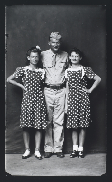 Mike Disfarmer,Soldier with Two Girlsin Polka Dot Dresses, 1943, 17 x 12 in.