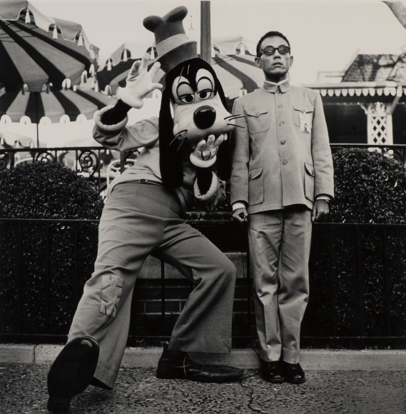 Tseng Kwong Chi, Disneyland, California, 1979, gelatin silver print, 36 × 36 in.