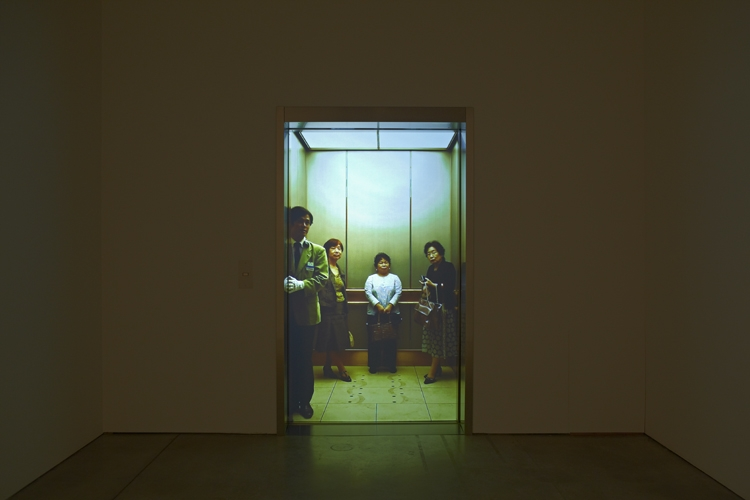 Leandro Erlich, Elevator Pitch, 2011, stainless steel, automatic door operator, sliding doors, button panel, screen, Mac Mini computer, and rear-screen video projection (color, sound), 5 min.