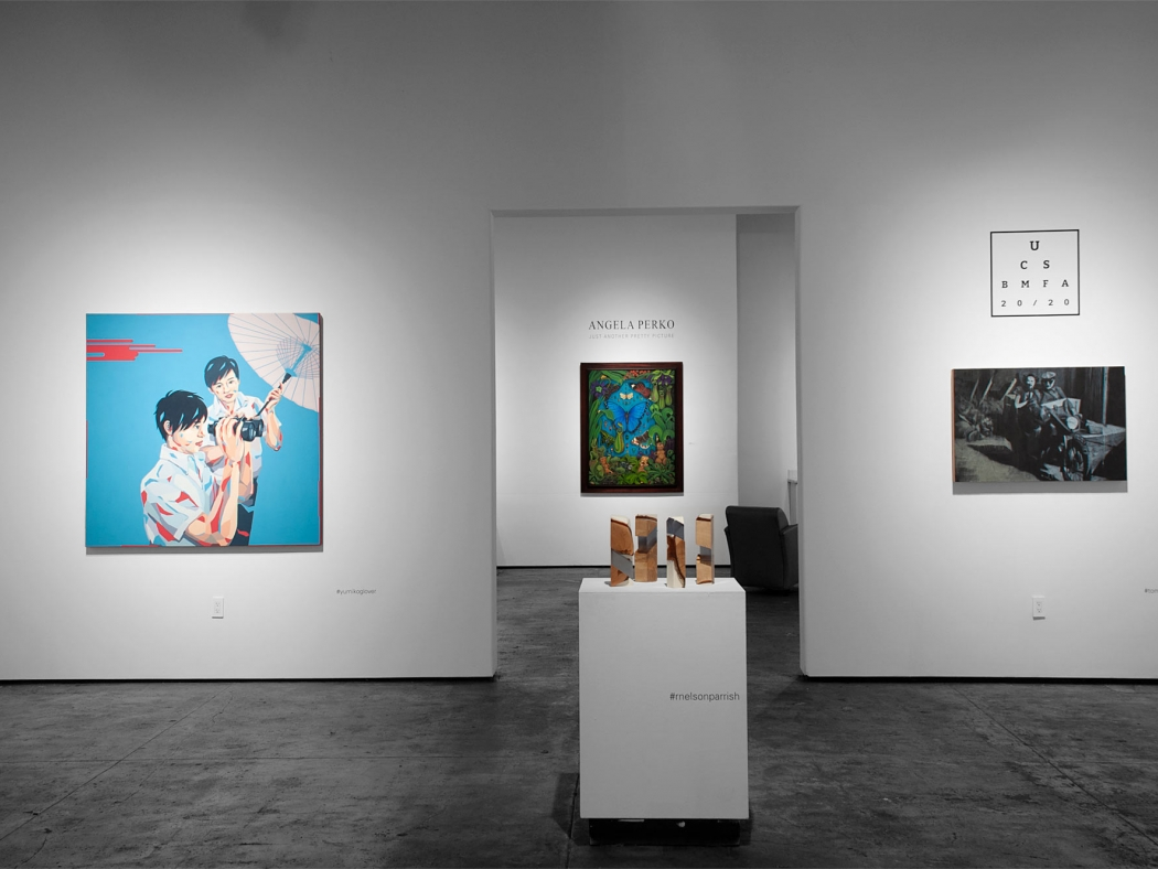 Installation shot of U.C.S.B. M.F.A. 20/20 Exhibition with ANGELA PERKO: Just Another Pretty PIcture exhibition in background