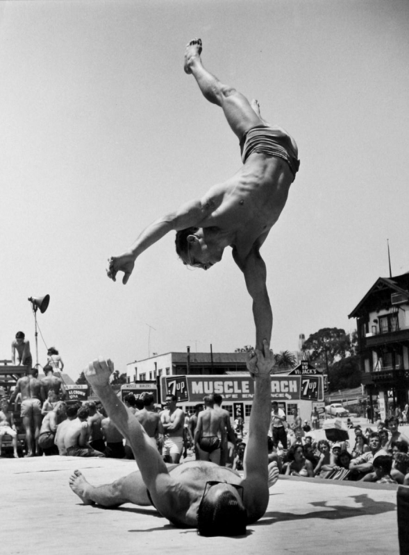 Larry Silver - Two Men Doing a Handstand, Muscle Beach, Santa Monica, 1954 Gelatin silver print, printed later | Bruce Silverstein Gallery