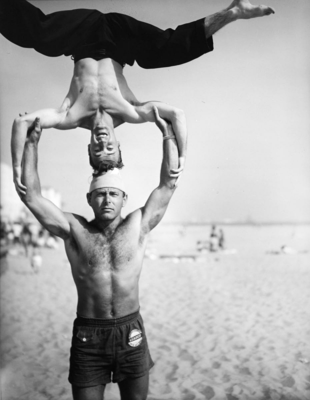 Larry Silver - Headstand, Muscle Beach, Santa Monica, 1954 Gelatin silver print, printed later | Bruce Silverstein Gallery