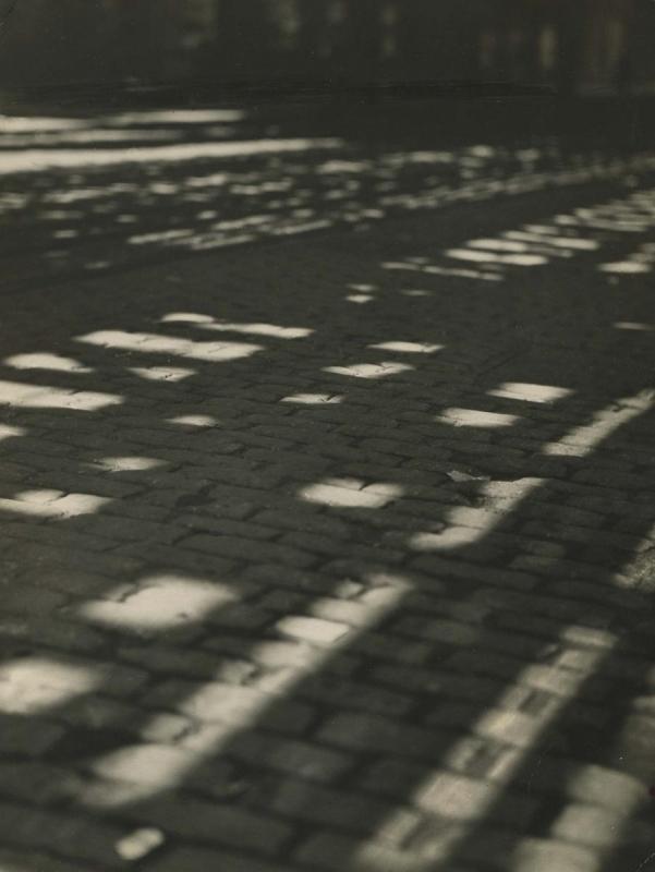 E. O. Hoppé - Sun Patterns on Cobblestones, New York City, 1921  | Bruce Silverstein Gallery